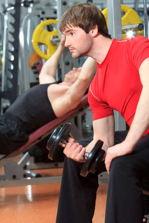 Sporty men in the gym centre. Stock Photo - 9837149