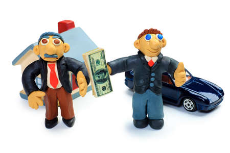 Shot of a plasticine businessmen in a suit holding money. Isolated over white background. Stock Photo - 9837153