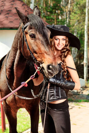 Beautiful young woman in medieval costume is riding on horseback. Stock Photo - 9837287