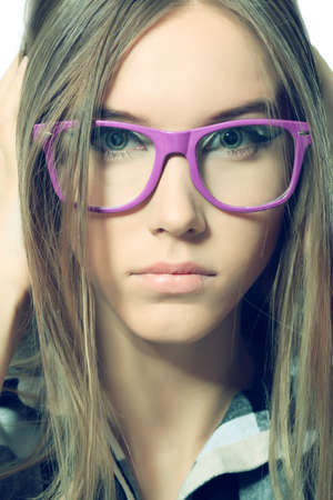 Portrait of a girl teenager in a big pink glasses. Isolated over white background. photo