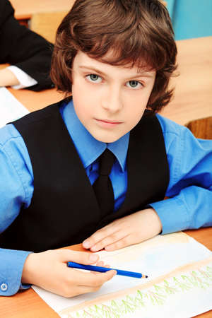 graduation suit: Portrait of a schoolboy in a classroom.