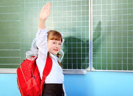 schoolgirl uniform: Portrait of a pretty schoolgirl in a classroom.