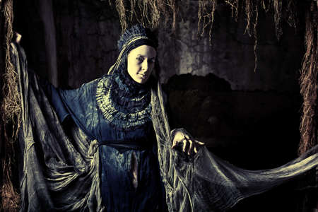 witches: Shot of the woman in old-fashioned dress.