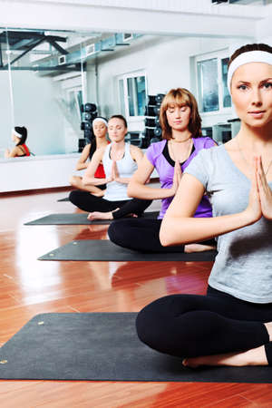 lithe: Group of young women in the gym centre. Yoga.