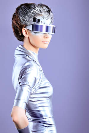 futuristic girl: Shot of a futuristic young woman wearing glasses.  Stock Photo