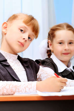 schoolgirl uniform: Portrait of a schoolgirls in a classroom.