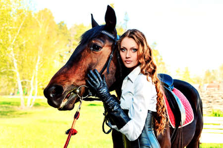 Beautiful young woman with a horse outdoor. photo
