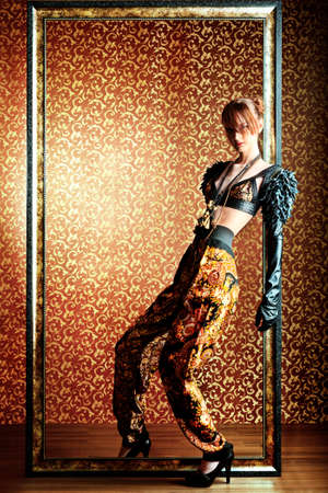 vogue: Fashion shot of a beautiful model over vintage background.