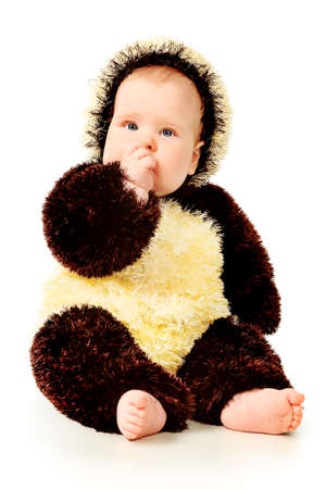 Beautiful baby in panda costume. Isolated over white. photo