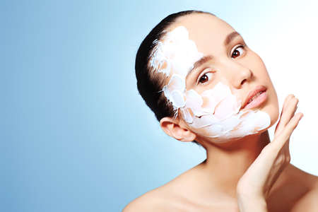 facial cream: Portrait of a woman with spa mask on her face. Healthcare, medicine. Stock Photo