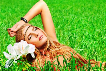 Beautiful young woman hippie posing outdoor. Stock Photo