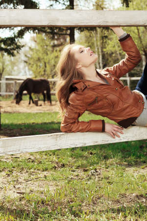 Beautiful smiling young woman outdoors. photo