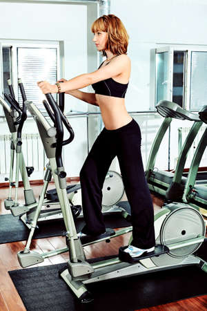 Young woman in the gym centre.  photo