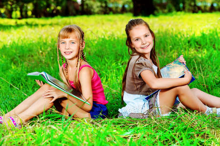 schoolgirls: Two cheerful girls having fun outdoors. Stock Photo