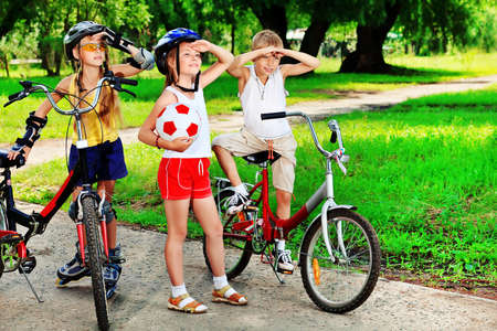 Group of active children in a summer park. Stock Photo - 10133114