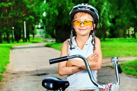Happy boy on a bicycle in a summer park. Stock Photo - 10132980