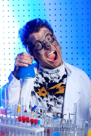 Medical theme: funny crazy scientist is working in a laboratory. photo