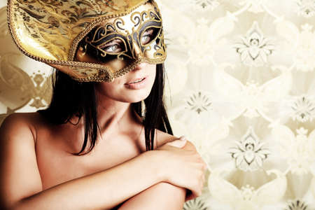 Shot of a sexy woman in a mask over vintage background. Stock Photo - 10213525