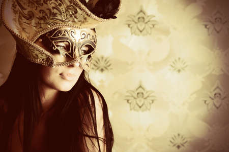 Shot of a sexy woman in a mask over vintage background. Stock Photo - 10213476
