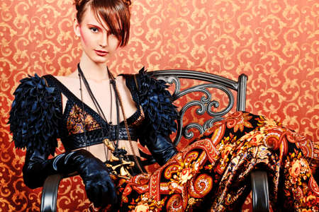 Fashion shot of a beautiful model over vintage background. photo