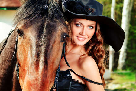 Beautiful young woman in medieval costume is riding on horseback. Stock Photo