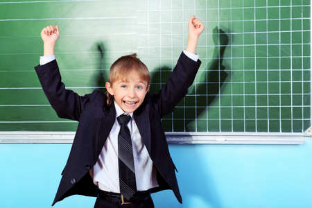 Cheerful schoolboy at a classroom. Education. Stock Photo - 10250741