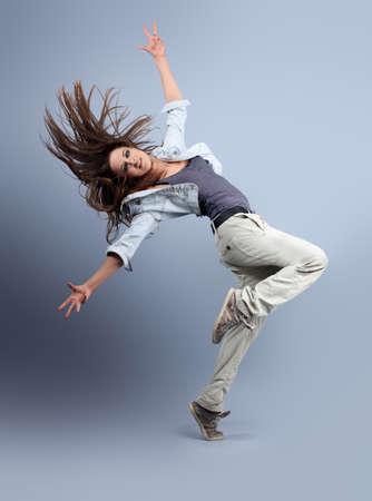 break dance: Teenage girl dancing hip-hop at studio.