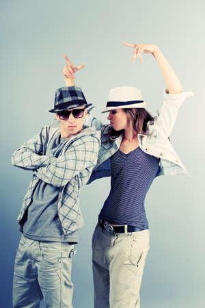 hip  hop: A couple of young man and woman dancing hip-hop at studio. Stock Photo