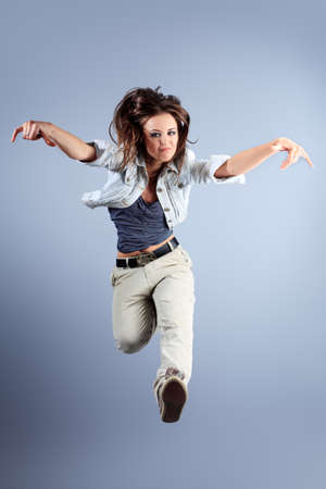 girl action: Teenage girl dancing hip-hop at studio.