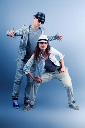 A couple of young man and woman dancing hip-hop at studio. Stock Photo - 10282428