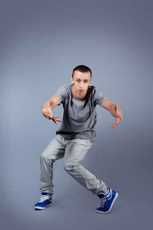 Young man dancing hip-hop at studio. Stock Photo