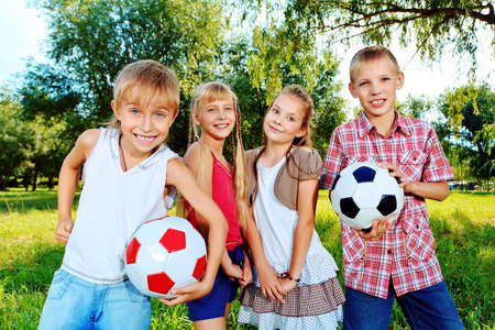 Group of cheerful children in a summer park.