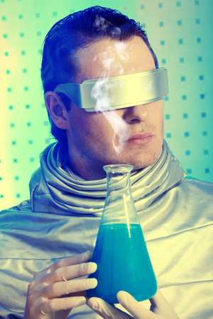 Medical theme: futuristic scientist is working in a laboratory.  photo