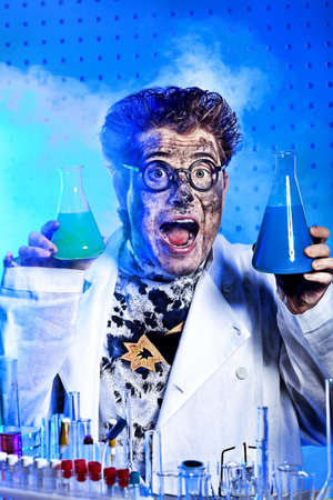 mixing: Medical theme: funny crazy scientist is working in a laboratory.