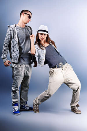dance pose: A couple of young man and woman dancing hip-hop at studio. Stock Photo