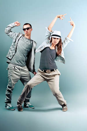 A couple of young man and woman dancing hip-hop at studio. Stock Photo - 10369189