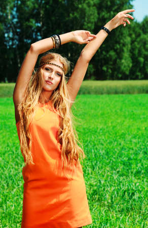country girl: Beautiful young woman hippie posing outdoor. Stock Photo