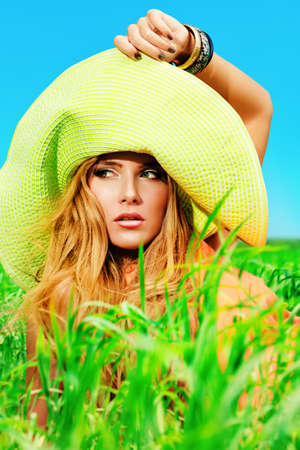 hat nude: Beautiful young woman in a hat outdoors. Stock Photo