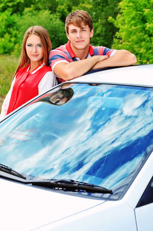 Happy young couple having summer trip on a car. Stock Photo - 10385335