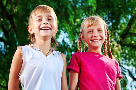 child couple: Couple of cheerful children in a summer park.