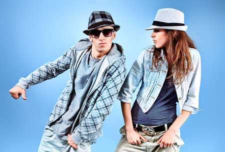 hip hop dancing: A couple of young man and woman dancing hip-hop at studio. Stock Photo
