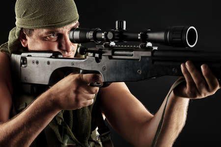 special forces: Shot of a conceptual soldier painted in khaki colors. Over black background.