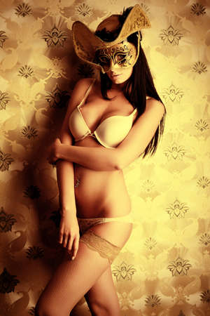 hat nude: Shot of a sexy woman in erotic lingerie over vintage background. Stock Photo