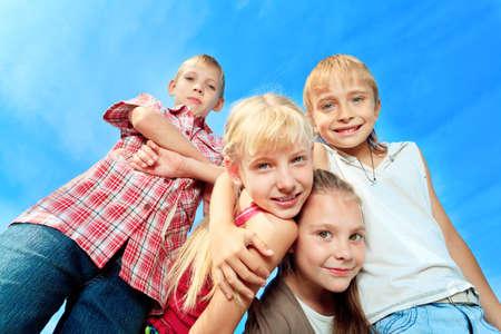 kid friendly: Group of happy children having fun outdoors.