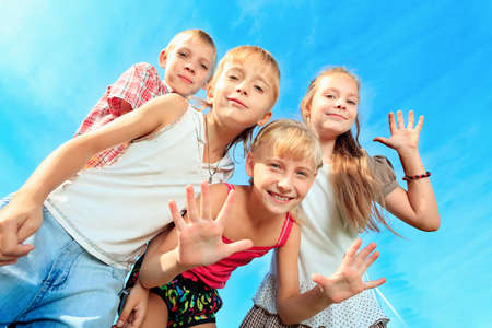 education success: Group of happy children having fun outdoors.