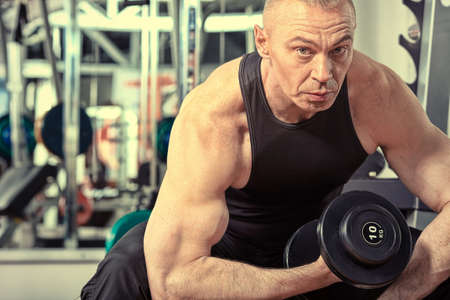 Mature sporty man in the gym centre. Stock Photo - 10453097