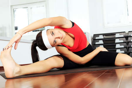Young woman in the gym centre. Stock Photo - 10488911