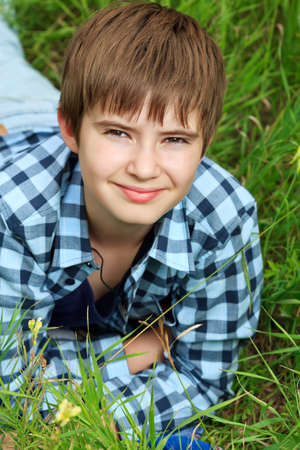 Portrait of a happy boy teenager outdoors. Stock Photo - 10489634