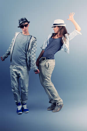 rapping: A couple of young man and woman dancing hip-hop at studio. Stock Photo