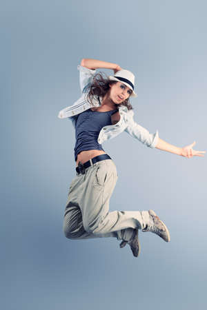 break dancer: A couple of young man and woman dancing hip-hop at studio. Stock Photo